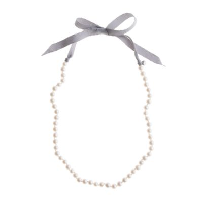 Girls' ribbon-tied long pearl necklace