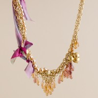 Faceted raindrop ribbon cluster necklace