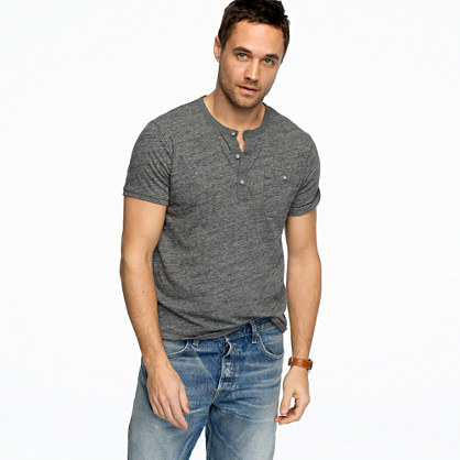 Henleys can be long- or short-sleeved. Short-sleeved versions look much like a polo shirt without the turndown collar, while long-sleeved ones resemble a sweater with a narrow (and buttoning) V-neck. The style isn't attached to any one traditional material or purpose the way the polo shirt is.