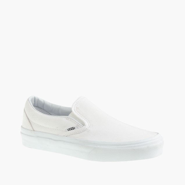 Vans® solid canvas classic slip-on sneakers in white