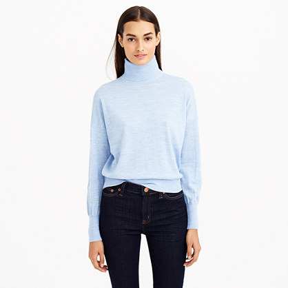 Our Signature Merino Turtleneck Poncho is pure Merino wool that is as soft as cotton and drapes as fluidly as silk, gently gliding over your curves. The asymmetrical hem adds visual interest while the turtleneck adds both warmth and classic style.
