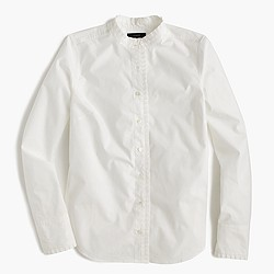 Ruffled button-up shirt in white