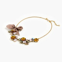 Crystal cluster necklace with bow