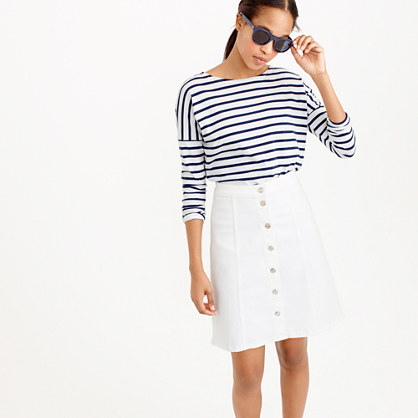 Button-front white denim mini skirt
