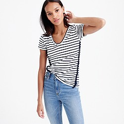 Striped V-neck top with pom-pom trim