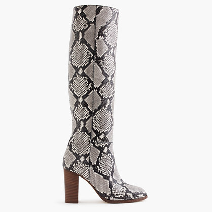 High-heel knee boots in snakeskin-printed leather