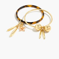 Tortoise and gold-plated charm bracelets