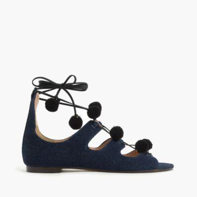 Denim caged gladiator sandals with pom-poms