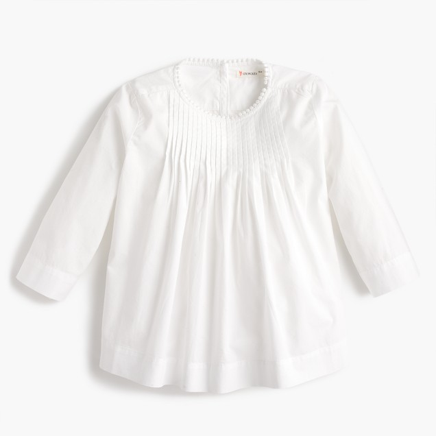 Girls' pleated top with pom-pom trim