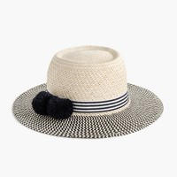 Straw hat with pom-poms