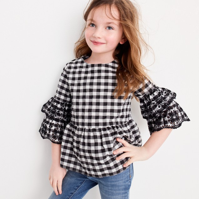 Girls' ruffle top with eyelet embroidery